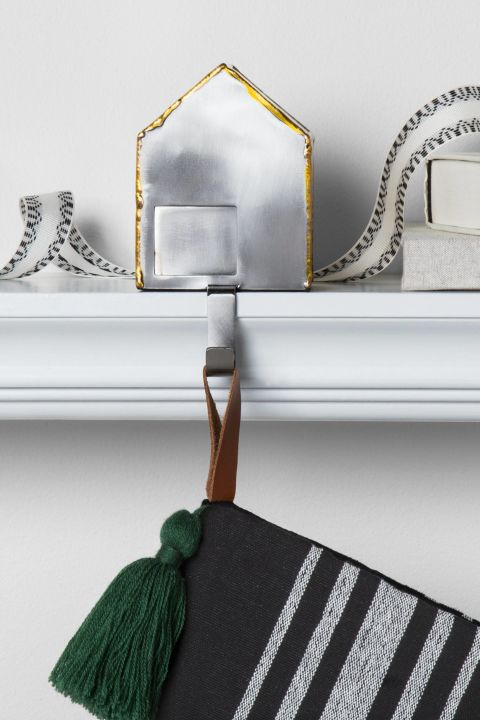 $10 BUY NOW Before you start poking holes in your mantel, consider investing in a set of handy hooks instead. These galvanizedhouses would form a mini Christmas village whenlined up in a row.