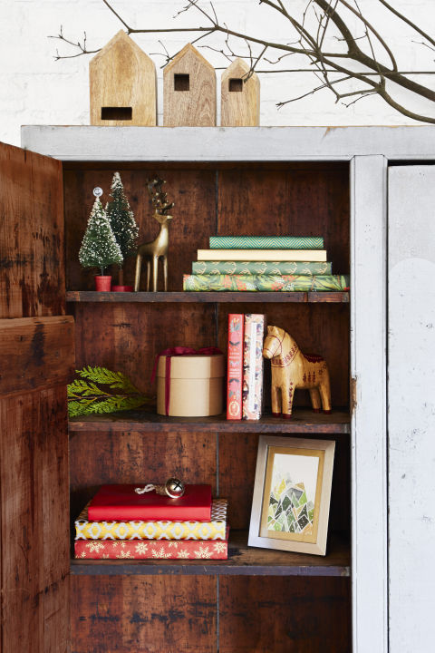 Wrap books with leftover wrapping paper for pretty spines, or swap in wintry prints and festive figurines.What you'll need: nesting houses ($17 for 3, target.com), Swedish horses, $45 for 3, worldmarket.com), wrapping paper set ($20 for 6, amazon.com), print ($31 and up, minted.com)
