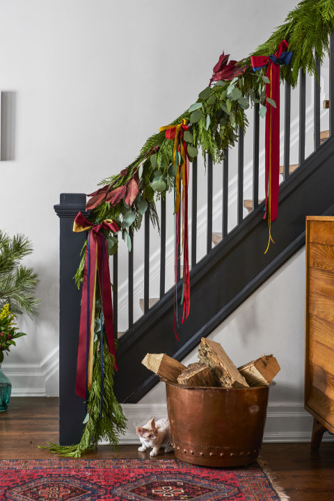 Line a banister with a fresh pine garland and crimson bows. Better yet, stir up some paint in a dramatic hue for a merry makeover you'll love even after the holidays. 