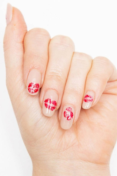 Make it look like someone &mdash; someone with very tiny lips &mdash; has planted one on each of your nails by painting slightly imperfect kiss marks with a red nail polish like OPI Big Apple Red ($10.50, amazon.com) on a nude backdrop.</p><p>See more at Cosmopolitan&amp;nbsp;»</p><p>