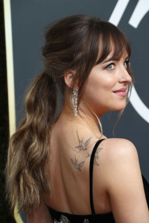 "The key to a Dakota Johnson-worthy ponytail that won't look droopy by the end of the night? It's simple! ""Tilt your head back while doing a ponytail,"" says celebrity hairstylist Marcus Francis. ""This trick makes the nape much tighter."""