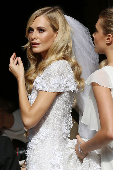 Boho waves are totally of-the-moment for weddings. Opt for a more polished version of the undone look — alá Poppy Delevingne at her 2014 wedding — by smoothing a product like Honest Beauty Honestly Polished Dry Condition + Shine Serum ($20, ulta.com) through styled strands.