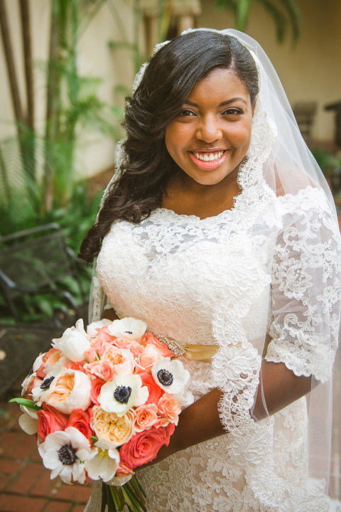 Beautiful bride Ayana Lage opted for a side-swept, wavy look that highlights her lace veil and natural makeup. Lock in a style that still needs to move with Frederic Fekkai One to Hold Hairspray ($28, ulta.com) .