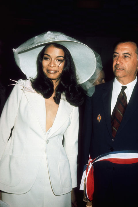 We can't all marry rockstars, but we can all take a page from Bianca Jagger's wedding style book, if we wish. She simply wore her hair long and straight with wavy ends and accessorized with an incredible wide-brimmed hat for her 1971 courthouse wedding to Rolling Stones frontman Mick Jagger.