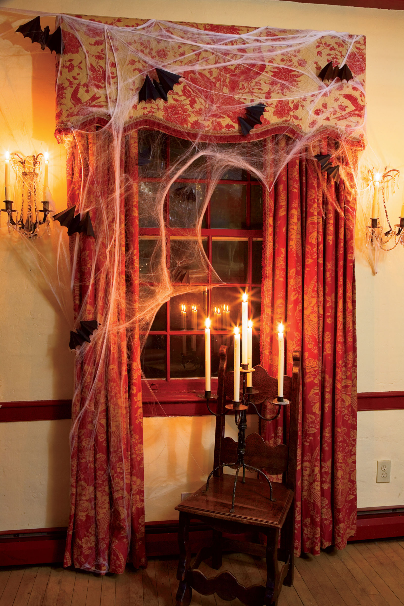 10 spooky window decorations to get your home ready for halloween modernize. Black Bedroom Furniture Sets. Home Design Ideas