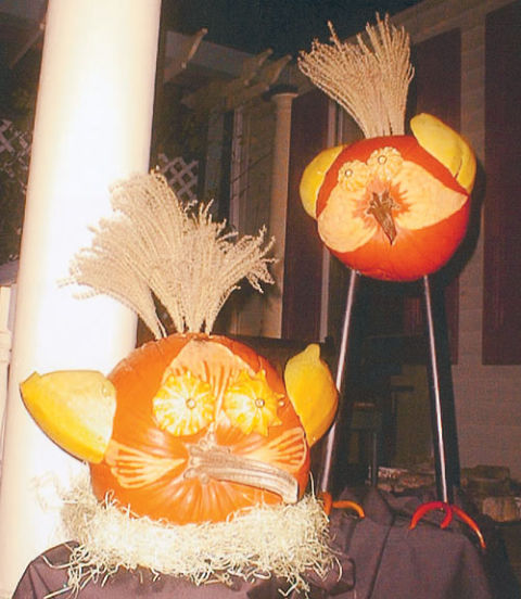 Pumpkins of a feather nest together — as seen here, on Linda Reamer-Hilbish's porch in Sewickley, Pennsylvania. (The tall, spindly legs are made of broomsticks.)