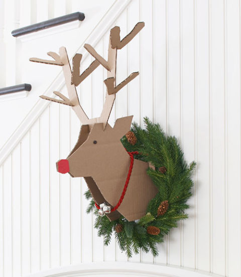 "Create this playful reindeer project with a couple of corrugated cardboard boxes and our handy template .</p><br /><br /> <p>Print out templates on 11x17"" paper.<br /><br /><br /> Trace the head twice, and the antlers once on corrugated cardboard (we purchased flat boxes from Staples).<br /><br /><br /> Cut out two head patterns. On the inside of each head pattern, score along the dotted line as shown on the pattern. To score, use an xActo knife to cut partially through the cardboard, which allows the cardboard to fold easily along that line.<br /><br /><br /> Place heads together so they are matching, making sure scored lines are on the inside.<br /><br /><br /> Glue nose section together, matching exactly, so the two heads are connected at the nose.<br /><br /><br /> Allow glue to dry.<br /><br /><br /> Open heads to form a slight V, and insert deer antlers in top grooves.<br /><br /><br /> Place rectangular brace in back.<br /><br /><br /> Add antler prongs in grooves.<br /><br /><br /> Glue red construction paper to either side of the nose (traced and cut out from template) .<br /><br /><br /> Use a black sharpie to draw circle for eye.<br /><br /><br /> Place reindeer head in wreath of your choice.</p><br /><br /> <p>NOTE: You will need Adobe Reader to view these files. Click here to download it for free."