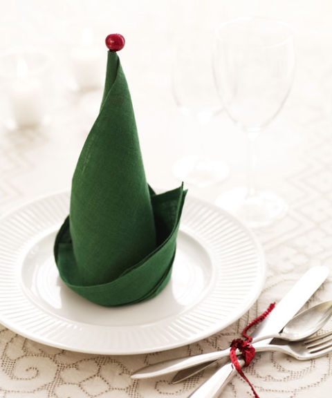 You might not have elves on call to set the table, but you can honor December's employees of the month by turning napkins into Santa's helpers' hats. To do: Gather square napkins that are on the stiff side (too thin or soft, and the folds won't hold). Once you've formed the hats, accessorize with mini-ornaments or jingle bells: Stick an ornament's hanger, or a bell looped onto a short piece of craft wire, into each hat's point. Place at holiday dinner guests' plates, and get ready to make merry.