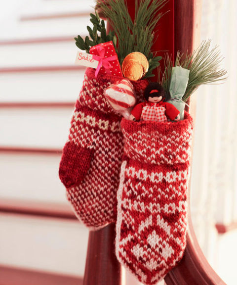 Assist stockings with the annual gift-dispensing duties by transforming mittens into hanging holders for tiny treats — simply stitch on a loop of ribbon.