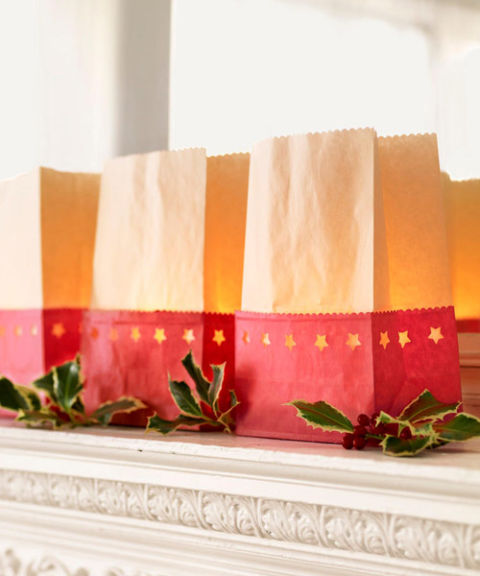 For luminarias, cut red paper bags in half with decorative scissors, and trim the tops of white or brown bags.