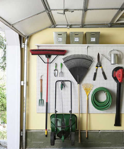If carport clutter is driving you mad, start by reclaiming your parking space. The trick: Utilize the walls. A securely mounted pegboard system will get your tools — rakes, hoses, even wheelbarrows — off the floor and out of the way, plus you'll always be able to see what you have. Carve out even more space by mounting a row of shelves above the board. Just keep a sturdy step stool or ladder handy so you can safely access overhead gear. Also: Make sure to secure bulkier items to the board with a bungee cord.
