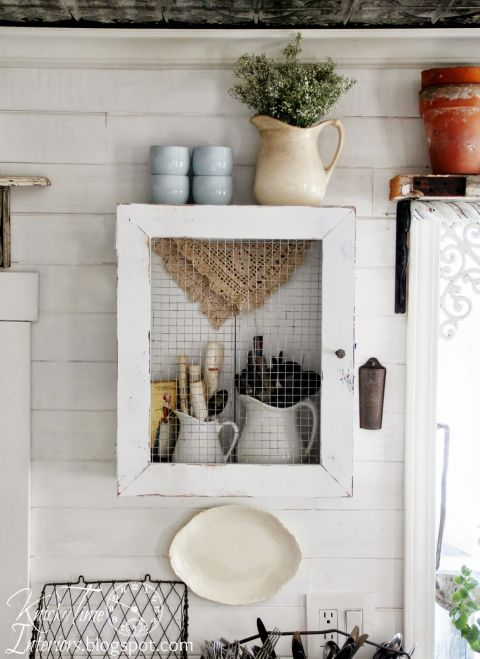 Display your utensils with style (but avoid the wrath of falling dust), by placing chic, white pitchers inside a rustic DIY cabinet. Get the tutorial at Knick of Time »