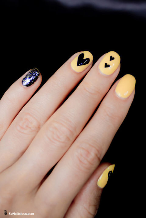 Don't feel like you have to stick to traditional colors like pink and red. Unexpected shade like buttery yellow — in this case, Sinful Colors Professional Nail Polish in Unicorn ($7, amazon.com) — and black work just as well with heart shapes. See more at So Nailicious »