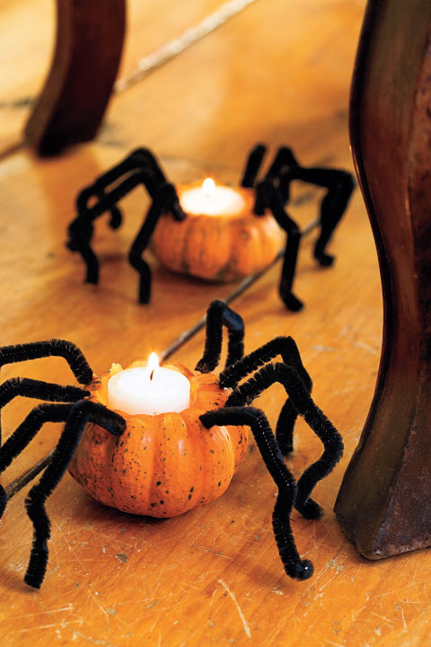 Light up the party with a spooky trail of spiders. Bent pipe cleaners bring to mind hairy tarantula legs when attached to mini pumpkins. 