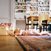 Child Laying On Area Rug