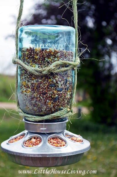 This smart blogger realized that a mason jar fits perfectly in the middle of a small, round chicken feeder. Storing seeds this way will keep your feathered friends visiting all season long. Get the tutorial at Little House Living »
