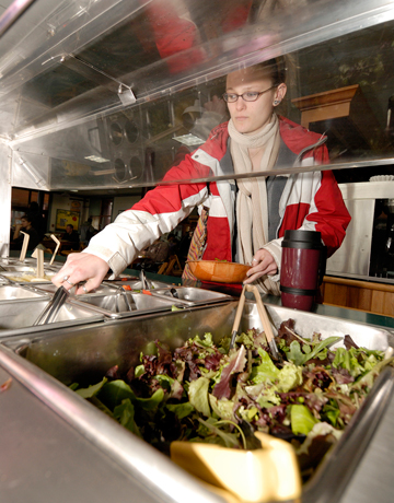 Green college cafeterias eco friendly dining halls green a student at college of the atlantic helps herself to organic salad bar in dining hall ccuart Gallery