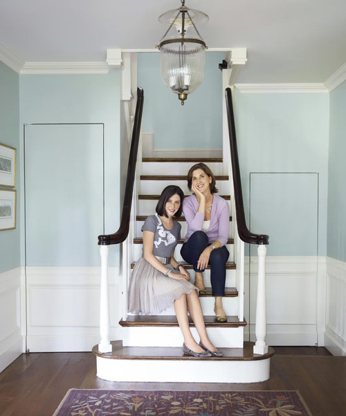 Mother And Daughter On Staircase