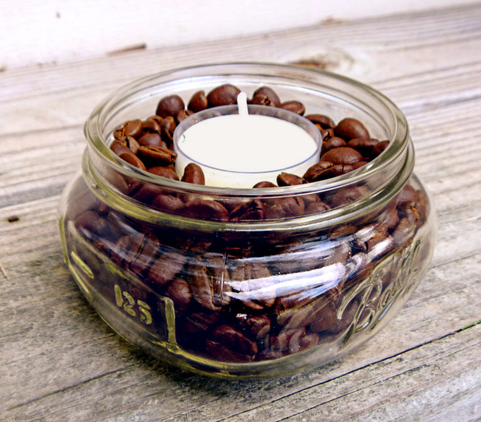 """I make these DIY coffee-scented candles by pouring beans (the cheaper, the better) into a small glass jar; just leave a quarter-inch of space on the top, then nestle a vanilla tealight in snugly. It smells like a fresh pot of vanilla coffee — even after the candles are out."" –Lisa Steele of Fresh Eggs Daily"