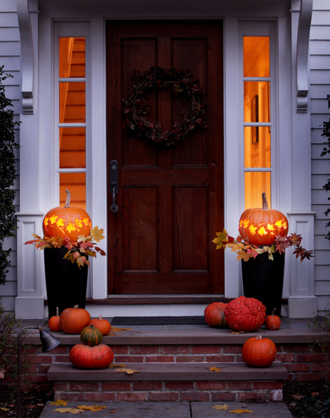 Copy the fall foliage outside with our easy pumpkin carving template. Plop the glowing lanterns atop a pair of planters to welcome trick-or-treaters. 