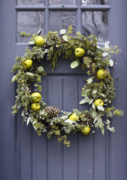 Peppermint-themed holiday decorations. mixed greenery wreath
