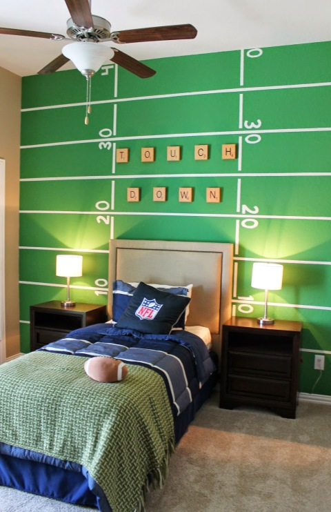 For the kid who lives in jerseys and grass stains, a football field wall means it's game time all the time. Complement the sporty look with DIY bedding in his favorite team's colors. See more at The Ragged Wren »