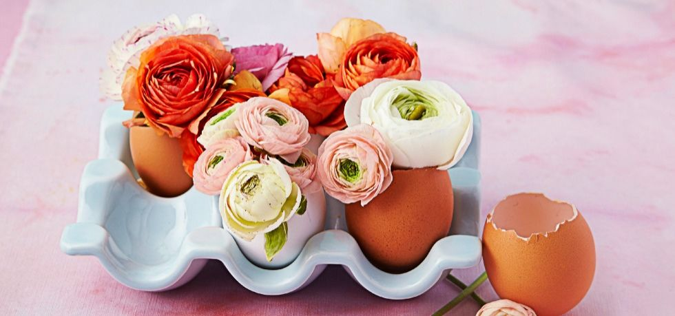 Crack eggs with a knife and drain to create a sweet vase for mini buds, like ranunculus (save the eggs for an Easter morning frittata.) Group in an egg carton for a charming garden effect.