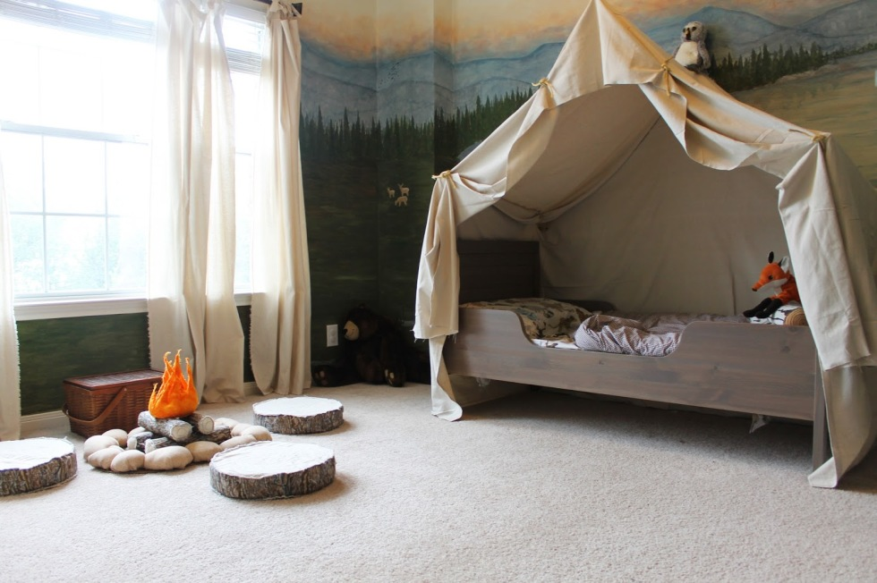 This isn't your average canopy: A dramatic drape turns a twin-sized bed into the comfiest tent ever while a pretend fire makes for the perfect gathering place for sharing ghost stories, songs, and snacks. Finish off with plenty of snuggly flannel blankets for a cozy campfire feel. See more at The Ragged Wren »