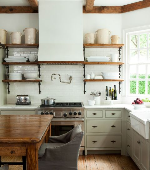 Barbara Westbrook, interior designer and author of Gracious Homes, knows the power of pale hues. She chose Pratt and Lambert's Chalk Grey paint for this kitchen's walls and range hood to brighten the room and impart a sense of openness. See more in Gracious Homes »