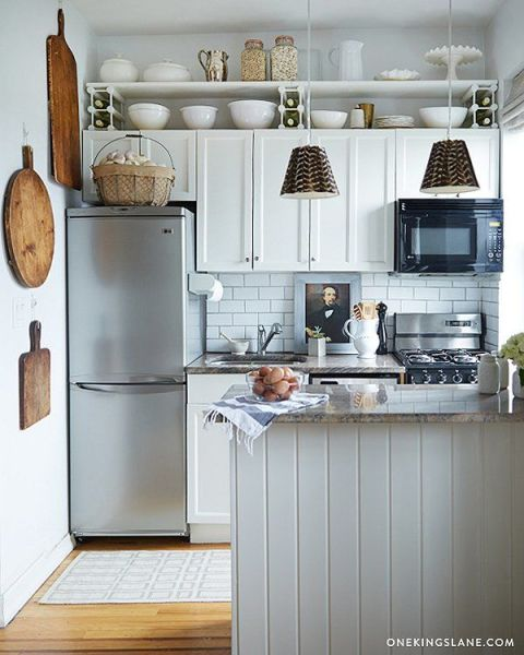 If your cabinets are too cramped to fit all of your kitchen gear, stealthily use the cuter items as decor. For instance, chunky vintage cutting boards or bright colanders can double as artwork. And a row of matching mixing bowls stuck above cabinets looks intentional, not messy. See more at One Kings Lane »