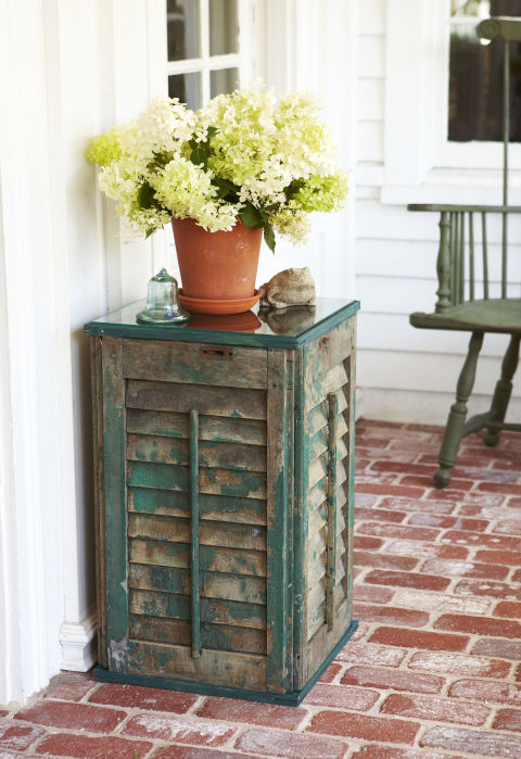 Skip painting and embrace a weathered finish for this tiny table. A set of rustic shutters provides the perfect base for a potted plant or a vase of blooms.  Get the tutorial »