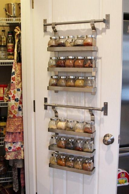 kitchen spice rack hung on door