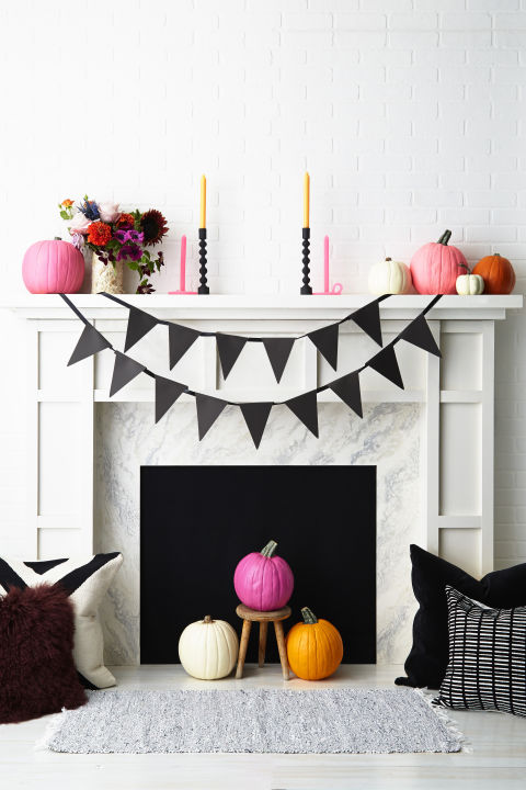 DIY a fun and festive banner by cutting flag shapes out of thick construction paper, spelling out your message and attaching to the mantel using ribbon or twine. What you'll need: black cardstock ($8, amazon.com), black ribbon ($10, amazon.com)