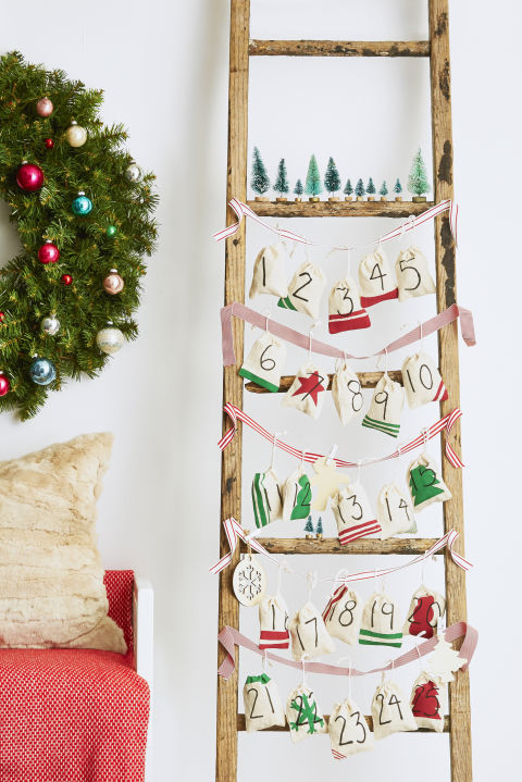 A fun way to help your gang ear up for the holidays: This DIY Advent calendar. Have the kids paint or draw on muslin craft bags. Then fill the bags with goodies or do-good tasks to complete, and hang along festive ribbons on a wall or reclaimed ladder. Let the countdown begin!