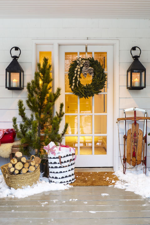 Your holiday wreath was looking a little lonely. Lean a untrimmed spruce next to the door for extra charm.