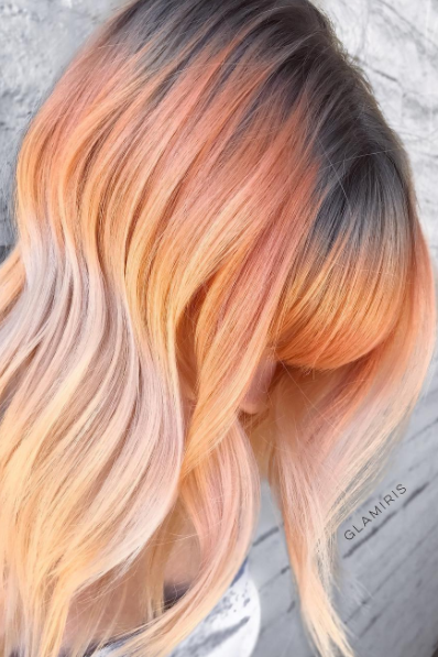 Moodierand cooler than blorange, smoked peaches and cream blends blonde, tangerine andcharcoal hues. Glam Iris, a California-based salon owner and theinventor of the trend, went for an ombré approach, playing up sooty roots before adding inorange in the midsection and blonde at the ends. The result? Your hair looks like a brilliant ocean sunsetthe moment before the sun slipsbelow the horizon.