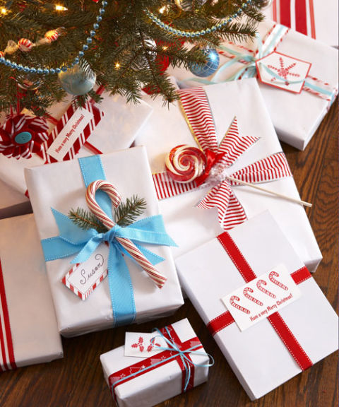 Streamline gift-giving by wrapping all your presents in the same pristine white paper brightened with bold color. It's elegant, economical, and easy to customize with tree cuttings, tags, and tempting candies.