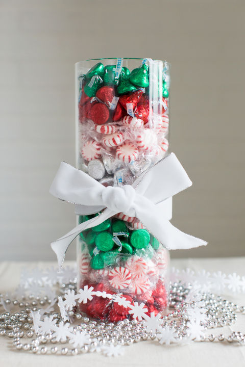 A bowl of treats sounds appealing, but you can take the presentation to the next level in just a few minutes. Separate red, green and silver-wrapped candy before layering in color-coded stripes. Get the tutorial »